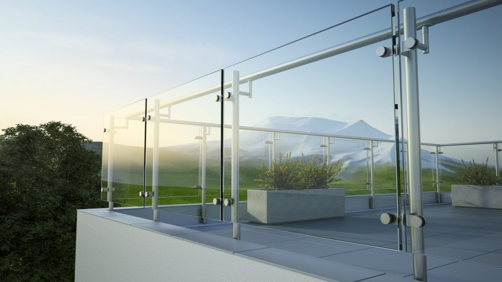 Modern stainless steel railing with glass panel and landscape view