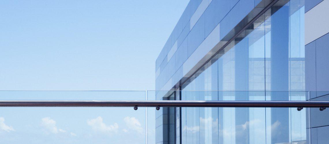 Glass railing on modern building balcony